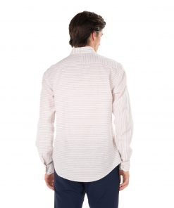 Asymmetric stripped shirt in yarn dyed cotton / linen hybrid fabric. Long sleeves and striped-pattern square chest pocket.