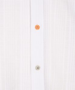 Pure cotton shirt with patterned fabric inserts down the button placket and on the inner collar. Contrasting embroidered dachshund on the left side.