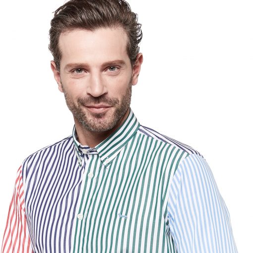 Striped patchwork shirt made from four pure cotton fabrics. Buttoned collar and embroidered dachshund on the left side.